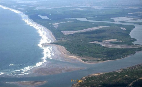 Aerial View of the South end of Island. Showing Sandino surf break and opening to ocean for Tesoro Marina